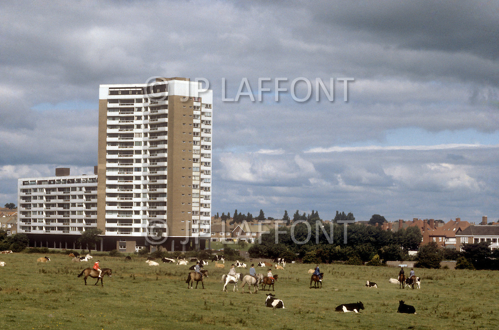 August 1981. Newcastle area, England. Outside Newcastle, the unemployed pass the time by going to the beach, the market, and the park to ride ponies or play with motorized toy boats.