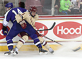 Adam Schmidt (HC - 14), Steven Santini (BC - 6) - The visiting College of the Holy Cross Crusaders defeated the Boston College Eagles 5-4 on Friday, November 29, 2013, at Kelley Rink in Conte Forum in Chestnut Hill, Massachusetts.