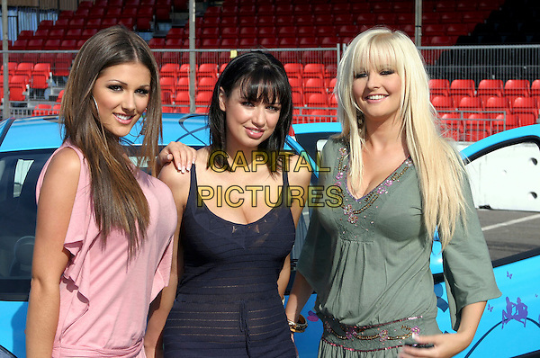 LUCY PINDER, SOPHIE HOWARD & MICHELLE MARSH .At the Max Power Live car show, Birmingham NEC, Birmingham, July 1st 2005..Half length models girls .Ref: JEZ.www.capitalpictures.com.sales@capitalpictures.com.©Jez Self/Capital Pictures