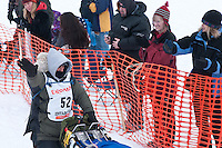 Musher # 52 Kim Darst at the Restart of the 2009 Iditarod in Willow Alaska