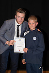 St Johnstone FC Academy Awards Night...06.04.15  Perth Concert Hall<br /> Zander Clark presents a certificate to Jack Simpson<br /> Picture by Graeme Hart.<br /> Copyright Perthshire Picture Agency<br /> Tel: 01738 623350  Mobile: 07990 594431