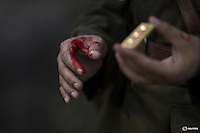 "An actor with fake blood on his hands holds a military epaulette as he prepares for a scene during filming of ""The Last Prince"" television series at Hengdian World Studios near Hengdian July 23, 2015. Extras and actors with smaller roles often take care of their own costumes and play more than one character in this production about the war against Japan. Director Li Xiaoqiang said the series is about a Qing Dynasty prince, who joined the Chinese nationalist army after suffering family misfortune. ""After he learnt more about the Communist Party, the prince began to understand what real revolution and the anti-Japanese war meant, and turned to the Communist Party to fight Japan"", the director added. According to local media, more than 10 new movies, 12 TV dramas, 20 documentaries and 183 war-themed stage performances will be released in China to coincide with the 70th anniversary of the end of World War Two. REUTERS/Damir SagoljPICTURE 14 OF 28 FOR WIDER IMAGE STORY ""BEHIND THE SCENES OF A CHINESE WAR DRAMA"".SEARCH ""SAGOLJ STUDIO"" FOR ALL PICTURES."