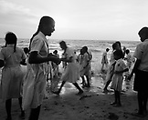 SRI LANKA, Asia, Colombo, school children playing at beach in Colombo. (B&W)