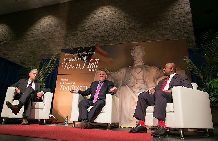 UNITED STATES - JULY 6 - GOP presidential hopeful and former Arkansas Gov. Mike Huckabee speaks alongside Rep. Trey Gowdy, R-S.C., left, and Sen. Tim Scott, R-S.C., during the Presidential Town Hall series at the Civic Center of Anderson in Anderson, S.C. on Monday, July 6, 2015. Photo By Al Drago/CQ Roll Call)