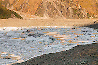 Tasman Glacier terminal lake with icebergs and icy debris after massive terminal face calving in 2010 under warm evening light, Mt. Cook National Park, Mackenzie Country, World Heritrage Area, New Zealand