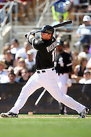 A.J. Pierzynski #12 of the Chicago White Sox plays in a spring training game against the Texas Rangers at Camelback Ranch on March 12, 2011 in Glendale, Arizona. .Photo by:  Bill Mitchell/Four Seam Images.
