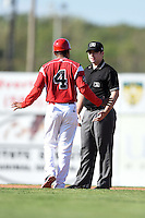 Batavia Muckdogs manager Angel Espada (4) argues a call with Umpire Donnie Smith during a against the Williamsport Crosscutters on July 27, 2014 at Dwyer Stadium in Batavia, New York.  Batavia defeated Williamsport 6-5.  (Mike Janes/Four Seam Images)