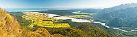 Views toward Waiho River and Franz Josef Glacier township. Lake Mapourika in distance and Tasman Sea on horizon, Westland Tai Poutini National Park, West Coast, South Westland, UNESCO World Heritage Area, New Zealand, NZ