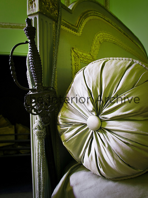Detail of a bolster against the upholstered end of a French daybed in the drawing room