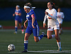 Brittany Munson #2 of Calhoun, left, moves a ball downfield as Olivia Dooley #10 of Manhasset gives chase during a Nassau County Conference AB1 varsity girls soccer game at Calhoun High School on Tuesday, Oct. 16, 2018. Munson scored her team's lone goal. The game, which was called with 9:57 remaining due to darkness, ended in a 1-1 tie.