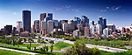 Calgary city downtown beautiful skyline panoramic view with Centre Street Bridge over Bow river, summer day urban scenery. Calgary, Alberta, Canada 2017.