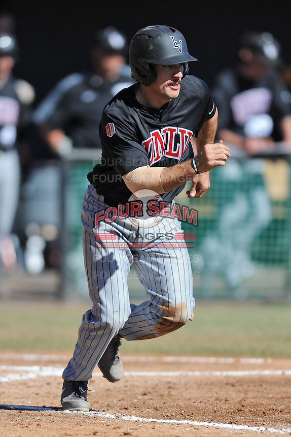 UNLV Runnin' Rebels catcher Craig Shul #31 runs to first during a game against the Tennessee Volunteers at Lindsey Nelson Stadium on February 22, 2014 in Knoxville, Tennessee. The Volunteers defeated the Rebels 5-4. (Tony Farlow/Four Seam Images)