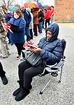 Robin Mays of Fairview Heights thumbs through a sales flyer in the comfort of her folding chair as she waits in a long line outside the JC Penney's store at St. Clair Square. She was going to be shopping for clothing for her grandchildren. Shoppers looking for bargains and discounted items endured a light but steady rain on Thanksgiving Day as they waited for stores to open in Fairview Heights, IL on November 28, 2019.<br />  Photo by Tim Vizer