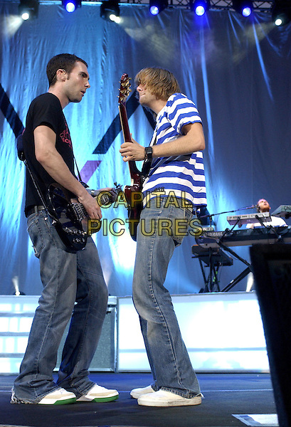 Adam Levine  & Jesse Carmichael of Maroon 5 .Performs live at The Verizon Wireless Ampitheatre in Irvine, California, July 17th 2004..full length gig music on stage concert playing guitar.Ref: DVS.www.capitalpictures.com.sales@capitalpictures.com.©Capital Pictures.