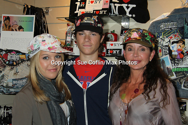 """One Life To Live's Kristen and Eddie Alderson with Jane Elissa - who tried on Jane Elissa's many Hats for Health on September 10, 2010 at the New York Marriott Marquis, New York, New York as Daytime's TV and  Broadway stars get involved in helping launch Jane Elissa's """"Hats For Health"""" to promote awareness and to raise money for Leukemia and cancer research.   (Photo by Sue Coflin/Max Photos)"""