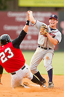 Ross Heffley (9) of the Rome Braves turns a double play as Michael Marjama (23) of the Kannapolis Intimidators slides into second base at CMC-Northeast Stadium on August 5, 2012 in Kannapolis, North Carolina.  The Intimidators defeated the Braves 9-1.  (Brian Westerholt/Four Seam Images)