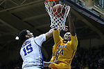 29 December 2014: Toledo's J.D. Weatherspoon (24) dunks over Duke's Jahlil Okafor. The Duke University Blue Devils hosted the University of Toledo Rockets at Cameron Indoor Stadium in Durham, North Carolina in a 2014-16 NCAA Men's Basketball Division I game. Duke won the game 86-69.