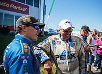 May 6, 2018; Commerce, GA, USA; NHRA funny car driver Ron Capps (left) with John Force during the Southern Nationals at Atlanta Dragway. Mandatory Credit: Mark J. Rebilas-USA TODAY Sports