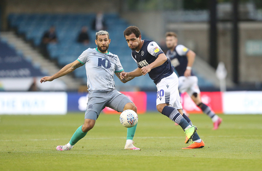 Millwall's Mason Bennett and Blackburn Rovers' Bradley Johnson<br /> <br /> Photographer Rob Newell/CameraSport<br /> <br /> The EFL Sky Bet Championship - Millwall v Blackburn Rovers - Tuesday July 14th 2020 - The Den - London<br /> <br /> World Copyright © 2020 CameraSport. All rights reserved. 43 Linden Ave. Countesthorpe. Leicester. England. LE8 5PG - Tel: +44 (0) 116 277 4147 - admin@camerasport.com - www.camerasport.com