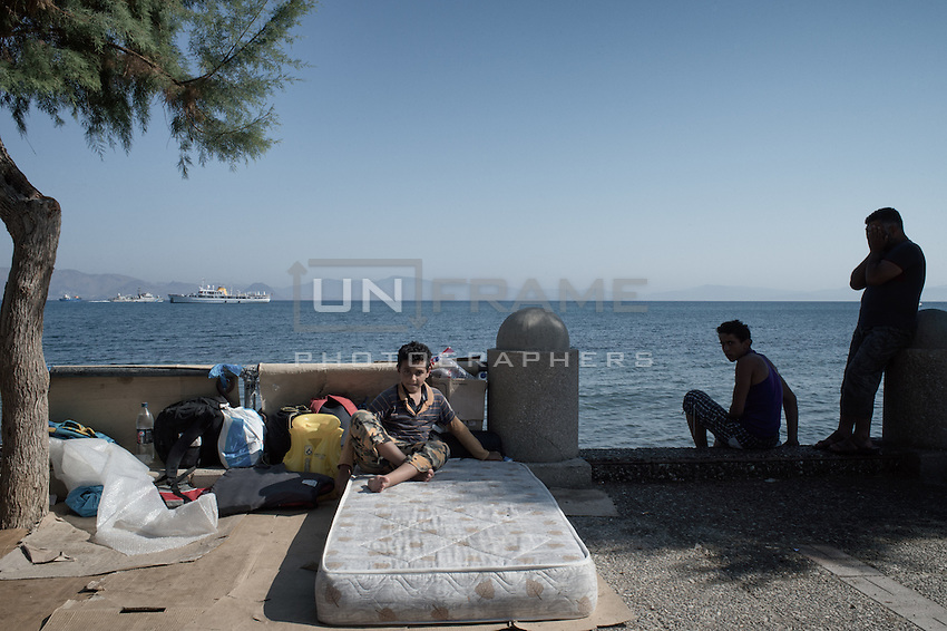 Syrian father with his two sons fled the war hoping to find a new life in Germany. They are waiting for permits to go to Athens. Kos, Greece. Sept. 5, 2015