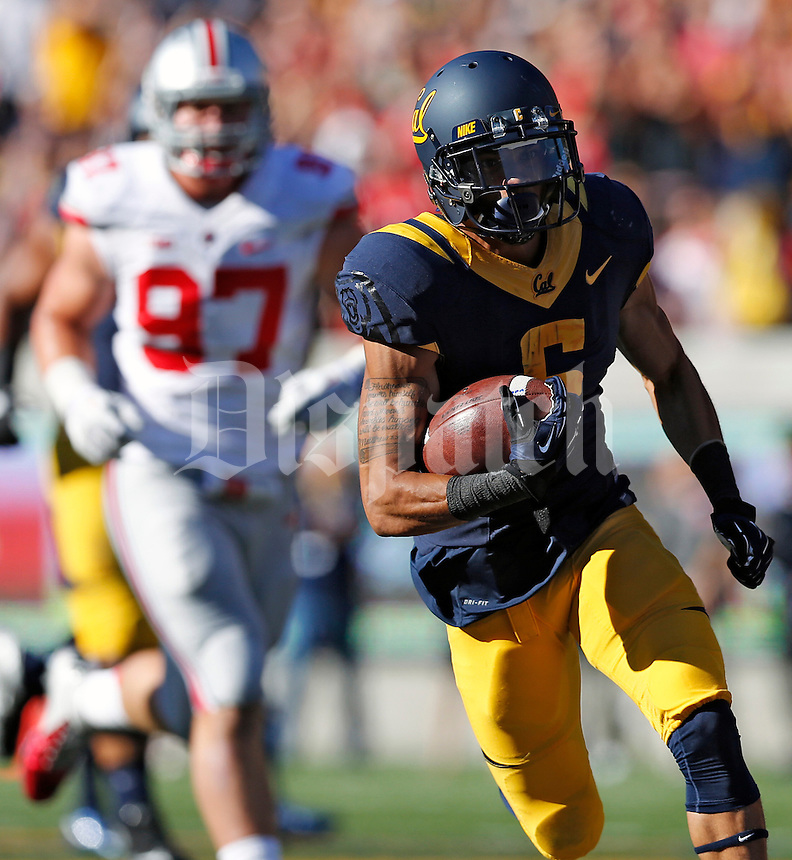 California Golden Bears wide receiver Chris Harper (6) carries the ball up field for a touchdown after a catch against Ohio State Buckeyes in the 1st quarter at Memorial Stadium in Berkeley, California on September 14, 2013.  (Dispatch photo by Kyle Robertson)