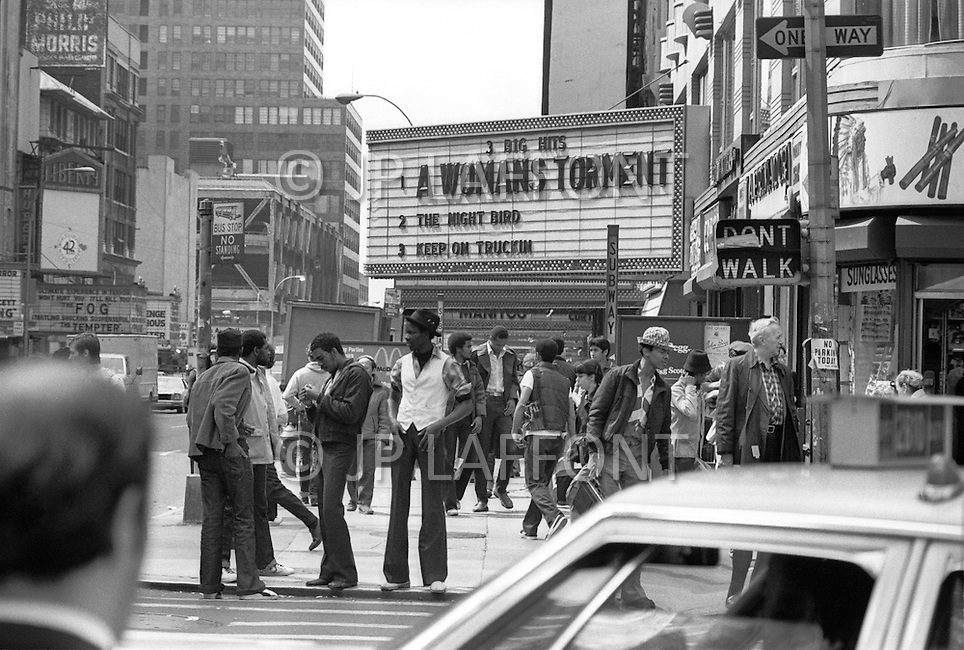 May, 1980. Manhattan, New York City, NY. Times Square street corner. Traffic is heavy and chaotic.<br /> <br /> Manhattan, New York City, NY. Mai, 1980. Times square &agrave; la 43eme rue. Le trafic est intense 24 heures sur 24 et les encombrements sont incessants.