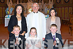 Pupils from Carranes NS Castleisland who recieved their first holy communion in St Stephen and John church Castleisland on Saturday front row l-r: Daniel Costello, Doreen Murphy, Aaron O'Connor.  Back row Cait Daly, Monsignor Dan O'Riordan and Ann Sugrue....