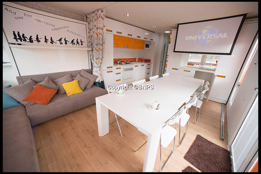 BNPS.co.uk (01202 558833)<br /> Pic: LauraDale/BNPS<br /> <br /> The caravan's communal area, with the fold-away table laid out to seat eight.<br /> <br /> A new mobile home that has movable walls to maximise the space the owner is using at the time is set to revolutionise the humble caravan holiday.<br /> <br /> The Concept Caravan measures 30ft by 13ft and uses the same area for different functions at different times.<br /> <br /> During the day, the movable bedroom wall is pushed back, freeing up an extra 60sq ft of room to create and impressive open-plan living space that has room for a 10 seater dining table.<br /> <br /> At night, the wall comes out and with it a foldaway bed to form a comfortable double bedroom.