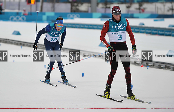 Andrew Musgrave (GBR, 10) finishes behind Dario Cologna (SUI). Mens 15km Skiathlon. Cross country skiing. Pyeongchang2018 winter Olympics. Alpensia cross country centre. Alpensia. Gangneung. Republic of Korea. 11/02/2018. ~ MANDATORY CREDIT Garry Bowden/SIPPA - NO UNAUTHORISED USE - +44 7837 394578