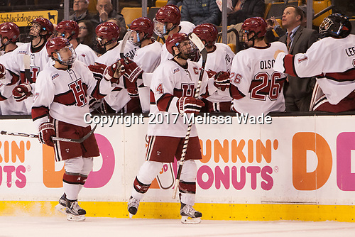 Viktor Dombrovskiy (Harvard - 27), Alexander Kerfoot (Harvard - 14) - The Harvard University Crimson defeated the Northeastern University Huskies 4-3 in the opening game of the 2017 Beanpot on Monday, February 6, 2017, at TD Garden in Boston, Massachusetts.