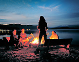 USA, Idaho, family camping enjoys the campfire by Priest Lake