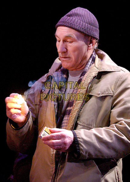 "PATRICK STEWART.Photocall for play ""A Life in Theatre"", Apollo Theatre, Shaftesbury Avenue, London, 1st February 2005..half length hat on stage costume match fire flame.www.capitalpictures.com.sales@capitalpictures.com.©Capital Pictures."