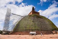 Sacred City of Anuradhapura, restoration work at Abhayagiri Dagoba at the Abhayagiri Monastery (Abhayagiri Vihara), Sri Lanka, Asia. This is a photo of restoration work at the Abhayagiri Dagoba at the Abhayagiri Monastery (Abhayagiri Vihara) in the Sacred City of Anuradhapura, a complex of ancient Buddhist dagoba ruins.