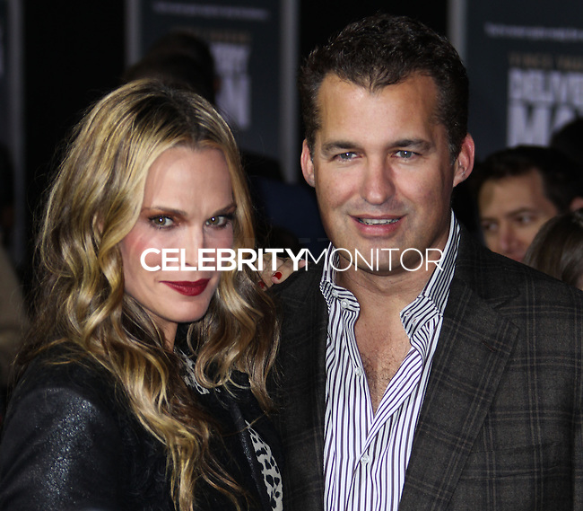 "HOLLYWOOD, CA - NOVEMBER 03: Model/Actress Molly Sims and her husband Scott Stuber arrive at the Los Angeles Premiere Of DreamWorks Pictures' ""Delivery Man"" held at the El Capitan Theatre on November 3, 2013 in Hollywood, California. (Photo by Xavier Collin/Celebrity Monitor)"
