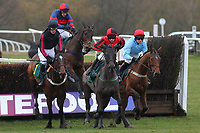 The field in jumping action in the William Bulwer-Long Memorial Novices Fox Hunters Chase