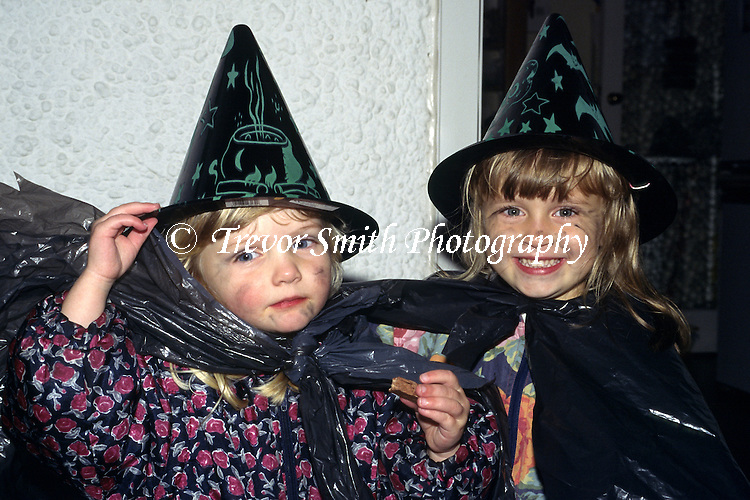 Young Children dressed in Halloween witches outfits