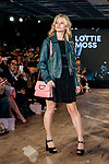Lottie Moss holding up a Samantha Thavasa bag walks down the runway during the Samantha Millennial Stars promotional event on April 27, 2017, Tokyo, Japan. The Japanese fashion and accessories brand is launching a new television commercial directed by Terry Richardson that features the five millennial models. (Photo by Rodrigo Reyes Marin/AFLO)