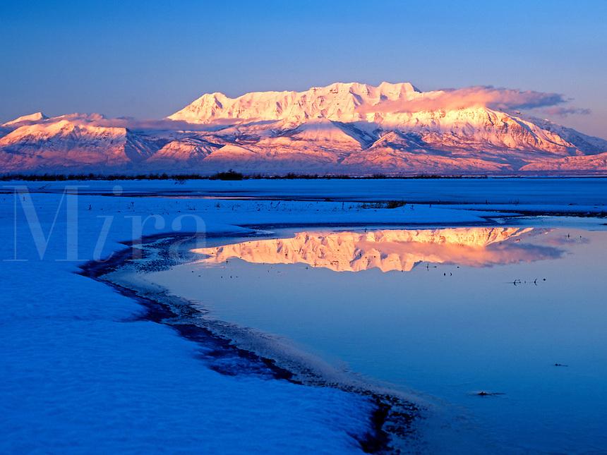 Mount Timpanogos rises above Utah Lake in central Utah in this winter scene<br />