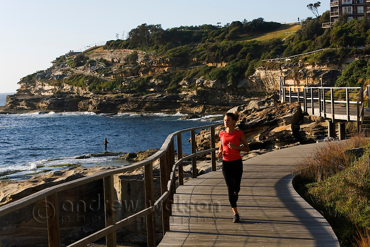 Morning runner on the Bondi to Coogee Beach coastal path.  Sydney, New South Wales, AUSTRALIA.