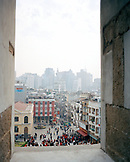 CHINA, Macau, Asia, Cityscape and crowd through ruins of St. Paul, 17th century, Cathedral, UNESCO world heritage site, catholic
