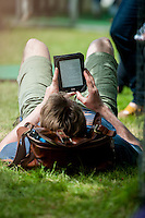 Tuesday 31 May 2016. Hay on Wye, UK<br /> Pictured: A man relaxes and reads in the sun <br /> Re: The 2016 Hay festival take place at Hay on Wye, Powys, Wales