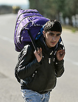 Pictured: A young male migrant, walks on the motorway to get to Idomeni, Greece Wednesday 02 March 2016<br /> Re: More migrants have been arriving at the Greek FYRO Macedonian border of Idomeni, Greece.