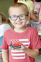 LYNN KUTTER ENTERPRISE-LEADER<br /> Troy Hurbbard, 6, of Lincoln, shows off his space ship made out of Legos. He was attending the summer reading program at Lincoln Public Library on this day.