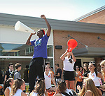 WATERTOWN, CT, 31 August, 2017 - 083117LW06 - Watertown High School senior Maurice Burrus Jr., left, and sophomore Sophia Lee entice freshmen students to join the cheerleading team with a cheer in the courtyard Thursday. <br /> Laraine Weschler Republican-American