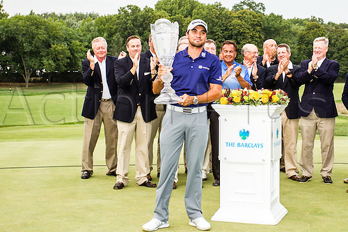 August 30, 2015: Jason Day with The Barclays trophy after winning The Barclays with a score of 19 under at Plainfield Country Club in Edison, NJ.