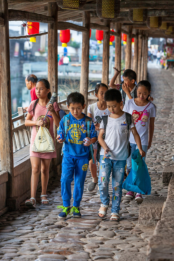 Yantou, Yongjia, Zhejiang, China.  Schoolchildren Walking Along Lishui Street.