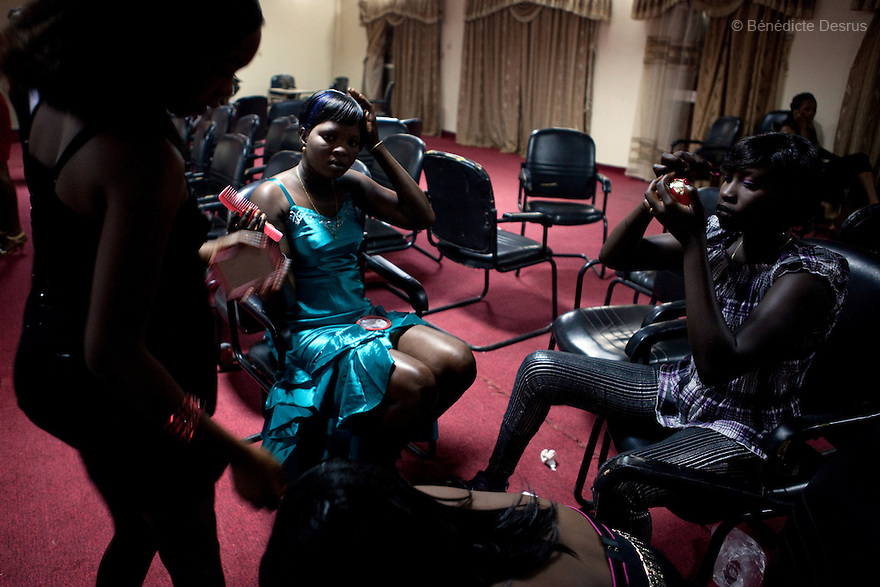 "4 december 2010 - Juba, Southern Sudan - Contestants getting ready to participate in Miss Malaika South Sudan 2010 at Nyakuron Cultural Centre Juba. The contest featured 15 women from all 10 of South Sudan's states. The event was a way to show off their talents, traditions and culture. The competition was originally put together in 2005 by the southern Sudanese diaspora living in neighbouring Kenya. The word ""Malaika"" means angel in Kiswahili, spoken widely in Kenya, the country where tens of thousands of southerners fled to, during ongoing conflicts. photo credit: Benedicte Desrus"