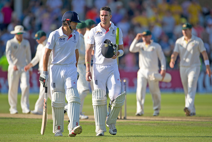England's Kevin Pietersen ( R ) and Alastair Cook (captain) leave leave the pitch after end of play<br /> <br />  (Photo by Stephen White/CameraSport) <br /> <br /> International Cricket - First Investec Ashes Test Match - England v Australia - Day 2 - Thursday 11th July 2013 - Trent Bridge - Nottingham<br /> <br /> &copy; CameraSport - 43 Linden Ave. Countesthorpe. Leicester. England. LE8 5PG - Tel: +44 (0) 116 277 4147 - admin@camerasport.com - www.camerasport.com
