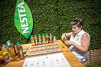 Visitors to Herald Square in New York receive samples of Nestea brand iced tea as well as view a tiny house that Nestea has brought on Wednesday, May 17, 2017. The 200 square foot tiny house symbolizes Nestea's less is more philosophy promoting simpler recipes in their bottled iced tea.  (© Richard B. Levine)
