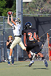 Beverly Hills, CA 09/23/11 - unknown Beverly Hills player(s) and Jason Burr (Peninsula #26) in action during the Peninsula-Beverly Hills frosh football game at Beverly Hills High School.